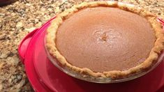 A hot pumpkin custard filling made with eggs, cream and pumpkin puree is spiced with ginger and cinnamon and baked in a chilled pie crust.