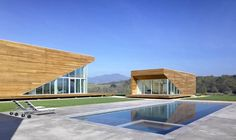 Great houses in boxes with a beatifull wood and an amazing pool...