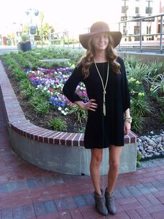 As Told by Stacy | Black dress, maroon floppy hat, gold lariat necklace. The perfect outfit for fall! You can shop these pieces on her blog