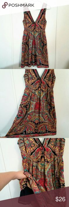 Angie Boho Paisley Dress Angie bohemian flowy dress in a gorgeous paisley print.  Purchased from Nordstrom.  Deep V-Neck and V-Back.  Stretchy under bust.  Black lining underneath, shorter than dress.  Excellent condition!  Size Medium Angie Dresses