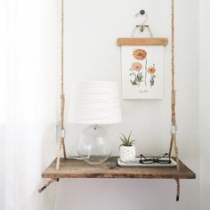 Floating swing side table. Can be used as bedside table or floating shelf. Includes hidden mount to keep it from swinging while maintaining the look of a hanging table & swing. / Elizabeth Ulrich Design