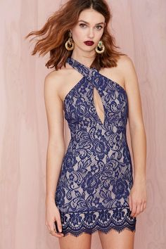 You and this dress? Match made on State Street. The Santa Barbara Dress has a crossover design at bodice, bust cups, front cutout, racer back, and navy blue lace overlay. Back zip closure, fully lined. Pair it with nude heels and a surfer.