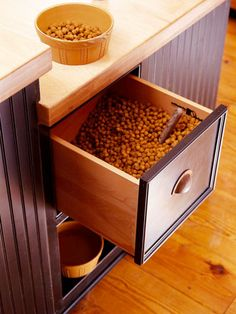 If man's best friend eats in the kitchen, why keep kibble in the garage? Pour Fido's dry food into a deep drawer, add a scoop, and voila--an easy way to keep dog food close at hand.
