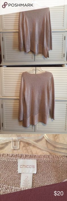Chico's long sleeve sweater Chico's long sleeve sweater, gold with metallic threads. It is a Chico's size 2, which would be a large. Beautiful detailing on the side and bottom hem as pictured. This would be a great holiday sweater and is long enough for leggings Chico's Sweaters Crew & Scoop Necks