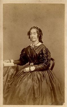 Portrait of a Woman wearing jewelry, including a large mourning brooch, c. 1860s