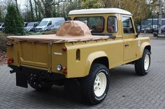 Land Rover Defender 110 pickup customized Twisted ICON in yellow. Soft top canvas. So nice