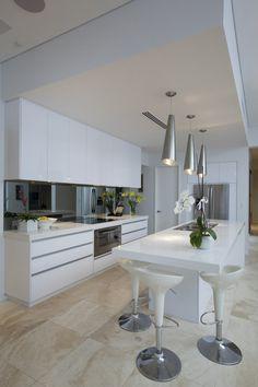 white and travertine kitchen.