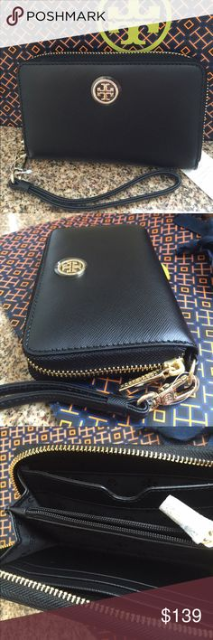 """🆕Tory Burch Robinson Smartphone Wristlet, Black. Black color scratch resistant Saffiano Leather Smartphone Wallet/Wristlet can hold up to an iPhone 6. Inside has a middle zipper compartment for change and 4 slip pockets for bills, credit cards, etc....Very versatile. All hardware is in gold and the leather strap is detachable. Approximate measurements: 6"""" L x 3.75"""" H x 1.25"""" D. New with tag, never used. Tory Burch Bags Clutches & Wristlets"""