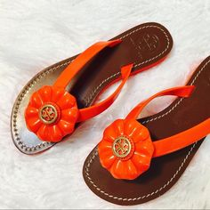 Tory Burch Breely Patent Leather Flower Sandals SS2- Adorable Breely Patent leather sandals. . Vegetta leather footbed. Rubber sole. Gold tone hardware. Slip-on style. NWOT Tory Burch Shoes Sandals