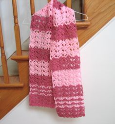 """Raspberry Swirl Crochet Scarf Yarn Weight: (4) Medium Weight/Worsted Weight and Aran (16-20 stitches to 4 inches) Materials: Red Heart Super Saver (364 yds/skein):  220 yds. each 0774 Light Raspberry, 0373 Petal Pink Crochet Hook: (US H-8) crochet hook or size needed for gauge Scarf Measures:   8"""" x 60"""""""