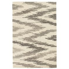 A grey-on-grey version of our best-selling  Chekat Ink rug, this micro-hooked wool area rug features a unique design made by combining traditional chevron and ikat patterns. With its durable weave, low profile, and versatile color combo, this wool rug is great choice for the living room, hallway, staircase, or bedroom.