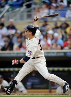 Justin Morneau #33 of the Minnesota Twins hits a solo home run against the Detroit Tigers during the second inning on May 26, 2012 at Target Field