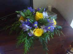 A simple table centre - yellow roses and blue iris