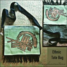 """TITLE : """"C"""" with Abstract. Cuteness MEDIUM : Fabric paints on Cloth. FEATURES :A plain striped white cloth painted with greens, greys and browns.A gold """"C"""" with abstraction made.Black piping, long sling and thready tassels made. #MeghnaCreations #creations #ethnictotebag #flapbag #c #means #cuteness #fabric #paint #plain #white #striped #clothpainted #artexpressionism #artiststyles #black #long #slingbag #thready #tassels #wearswag #funk #stylish #gift #pintrest"""