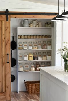 Sliding barn door in a farmhouse style kitchen