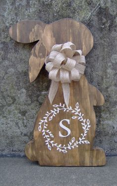 Spring bunny rabbits are soon to be in season. What a fun and decorative way to decorate any entry door or just display it on your wall Please make sure you ad the initial you wish to be on your rabbit in the memo to seller upon purchase. Approx. Measurement: 13.75x8 Materials: Wood,