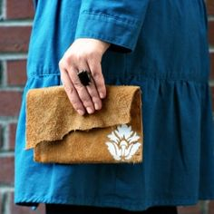 Follow this very simple tutorial to make your own leather clutch with a painted motif.
