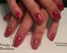 Nails with OPI polish and caption stamping plate.