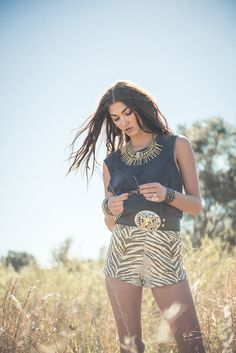 Sassy 'Jungle' shorts paired with an edgy embellished tank, western style belt, studded wrist wear and an edgy statement piece. Spell and the Gypsy Collective.