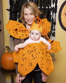 An adorable lily costume that attaches right to a baby carrier.