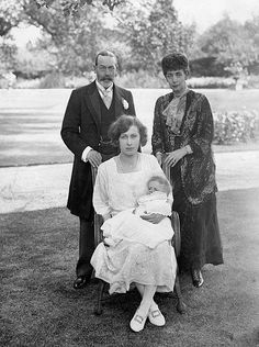 Four generations - Princess Mary with her first son, George, her father, King George V, and her grandmother, a rather frail looking Queen Alexandra, The Queen Mother.