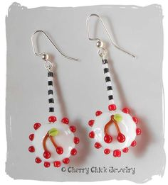 This one of a kind pair of Cherry Earrings have the little cherries on both sides of the earrings. Created from 20mm lentil shaped glass lampwork beads, they hang down 2 1/4 inches. Cherry cute! #CherryEarrings #Cherries
