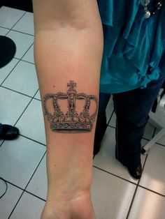 My Crown Tattoo- It represents my daughters and grandkids as they are my precious gems. Each one of their birthstone colors are the gems.