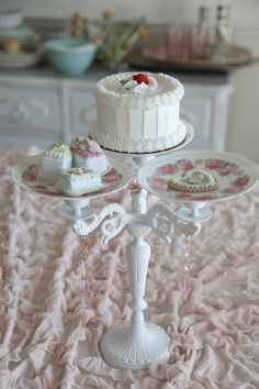 Pretty Dessert Stand With Pink Roses - plates and candelabra. Great idea, turning a candelabrum into a dessert stand!