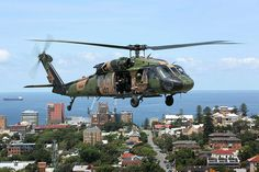 An Australian Army Black Hawk helicopter from 6th Aviation Regiment conducts a training activity at Newcastle, NSW, on 11 November 2015 as part of ongoing professional training to ensure pilots and aircrew are ready to fly in all conditions across the urban and rural environments.