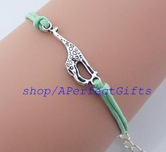 http://www.beautifulseasondiy.com/collections/frontpage/products/wholesale-giraffe-bracelet-charm-simple-rope-jewelry   Giraffe bracelet Simple giraffe jewelry Silver/bronze Charm,men jewelry women cuff,mint green string Choose your color,Wholesale or retail  by http://www.beautifulseasondiy.com/, $0.99