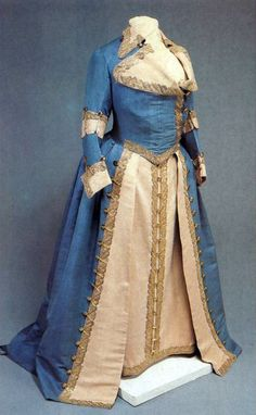 """Lady Mundirnye"" dress introduced by Catherine II as a female version of the uniforms of military units, and combined the features of the military form with elements of ancient and European women's dress to suit the second half of XVIII century. The Empress appeared in parades and during regimental celebrations in such a dress. The color and ornamentation of this dress is consistent with the Cavalry officer corps of 1764-1796."