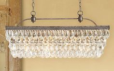 "2. Pottery Barn's Clarissa Glass Drop Extra-Long Rectangular Chandelier, 30"" in length."
