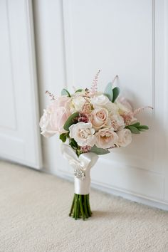 Luscious blush pink and cream roses with astilbe in this gorgeous #bridal bouquet.