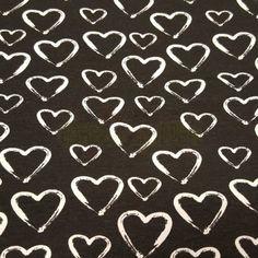Zwartwit Hartjes tricot - 12,95 € per meter - droomstoffen