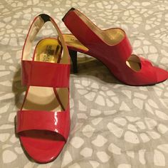 Michael Kors patent red cut out pump Very fun shoe. Patent red with a cut out design. Size 10, worn one time. Michael Kors Shoes Heels