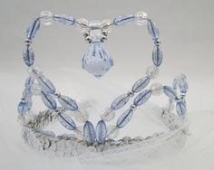 The perfect tiara to match her Cinderella dress! This tiara is made with attention to detail. The blue, clear and silver beads form a heart, which is finished in the center with a large dangeling blue jewel. The bottom of this Cinderella tiara is silv Princess Dress Up Clothes, Dress Up Outfits, Blue Beads, Silver Beads, Cinderella Dresses, Disney Sweaters, Winter Hoodies, Princess Costumes, Cool Things To Buy