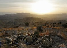 An American soldier sets up camp on a hill overlooking the Pakistani border in Khost Province during a four-day operation in search of insurgents and weapons caches