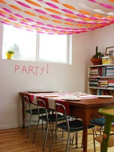 now this seems like a reasonable amount of intricacy for kid party decorations! i am definitely stealing the crepe paper on the ceiling move. for someday. Crepe Paper Decorations, Streamer Party Decorations, Party Streamers, Birthday Decorations, Streamer Ideas, Crepe Streamers, Ceiling Streamers, Ceiling Decor, Festival Party