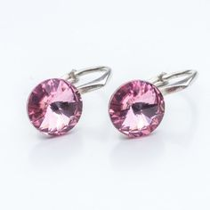 Swarovski Rivoli Earrings 8mm Light Rose  Dimensions: length: 1,7cm stone size: 8mm Weight ~ 1,85g ( 1 pair ) Metal : sterling silver ( AG-925) Stones: Swarovski Elements 1122 SS39 Colour: Light Rose 1 package = 1 pair