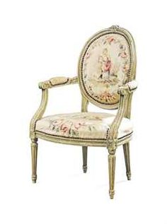 A FRENCH LOUIS XVI STYLE GREEN-PAINTED ARMCHAIR