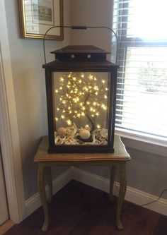 You know we love us some terrarium decor action. Let's talk about how to make this awesome light-up terrarium. These would make for super-stunning reception decor pieces.
