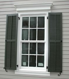 Black Shutter w/grey and white trim- love the thick window trim and REAL working shutters w/ louvers- not fake and nailed onto the house... ugh.