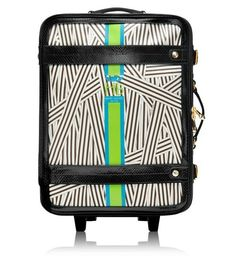 A chic piece of luggage is essential for carrying all your necessities, and this one has an edgy vibe with a shock of bright color -- perfect for Miami. via @stylelist