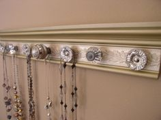 Champagne jewelry organizer. This necklace rack by Gotahangup, $39.00