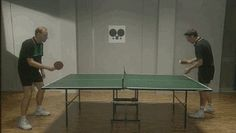 Two men playing table tennis... with a difference.  Hilarious!
