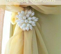 Best DIY Projects For Home Decorating: Cool Use for Napkin Rings.....As Drapery Hold Back...