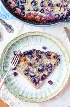 Blueberry Dutch Baby Pancake - So much easier than standing at the stove flipping pancakes. Only 2 eggs in this big, puffy, fluffy pancake! Recipe at averiecooks.com