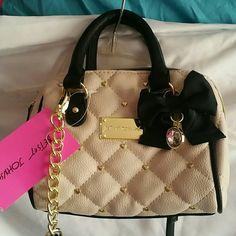 Mini Betsey Johnson Handbag/Crossbody Cream colored mini Betsey with longer strap to be worn as a Crossbody bag. NWT Betsey Johnson Bags Baby Bags