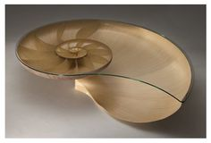 The Nautilus Table created by Marc Fish. Layering of over 4000 individual pieces of walnut and sycamore veneer has created the logarithmic spiral found within the Nautilus shell.
