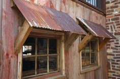 Interesting use of corrugated metal for window awnings. by aurelia